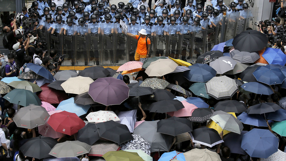 Hong Kong Protestors Resort to Violence, Umbrellas