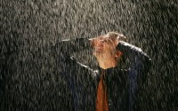 A man dressed in a shirt and tie with his hands on his head look to the sky in frustration in the pouring rain   Black Background,Outdoors,Caucasian,Isolated,Business,Businessman,Men,Male,People,Working,Office,Office Place,Adult,Concepts,Rain,Protection,Uncertainty,weather,daytime,day,daylight,shine, pouring,life,hopeless, upset, wet, forces of nature, shirt, tie, defeated, soaked, soaking wet, rain drops, washed up, washed out, drenched, despondant, storm, defeated, frustration