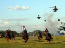 Troopers with the 1st Cavalry Division charge Cooper Field at Fort Hood, Texas, June 11, while helicopters from the 1st Air Cavalry Brigade soar overhead during a rehearsal of the Spirit of the Cavalry. (U.S. Army photo by Staff Sgt. Christopher Calvert, 1st Cavalry Division PAO (Released))
