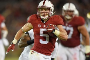 PALO ALTO, CA - OCTOBER 15:  Christian McCaffrey #5 of the Stanford Cardinal's rushes for a twenty eight yard touchdown run against the UCLA Bruins in the second quarter of an NCAA football game at Stanford Stadium on October 15, 2015 in Stanford, California.  (Photo by Thearon W. Henderson/Getty Images)