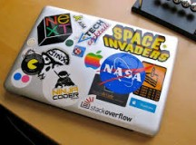 Student Starting to Question Laptop Stickers' Actual Relevance to His Life